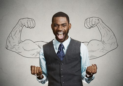 portrait happy successful business man winning, fists pumped celebrating success